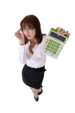 Young secretary. Holding calculation with worried expression Royalty Free Stock Image