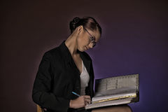 Young secretary or business woman with folders of paper Royalty Free Stock Photography