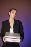 Young secretary or business woman with folders Stock Photo