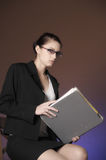 Young secretary or business woman with folders Stock Images