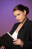Young secretary or business woman with folders Royalty Free Stock Images