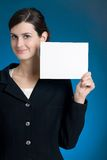 Young secretary or businesswoman with blank note card Royalty Free Stock Photography