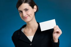 Young secretary or businesswoman with blank note card. Smiling Royalty Free Stock Photography