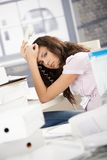 Young secretary having headache in office Royalty Free Stock Images