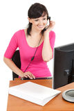 Young secretary with headset at work Royalty Free Stock Images