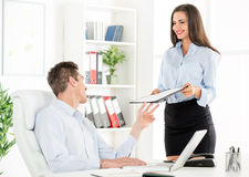 Young Secretary And Her Boss Royalty Free Stock Photo