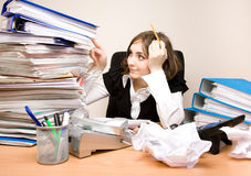 Young secretary with a lot of folders Stock Photography
