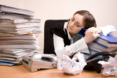 Young secretary with a lot of folders. Sleeping stock photography
