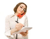 Young secretary making a note Royalty Free Stock Image