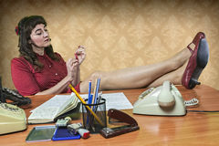 Young secretary with a nail file in the office Stock Images