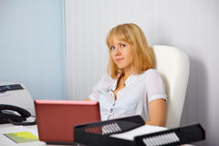 Young secretary in office workplace Royalty Free Stock Photography