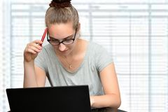 Young secretary in an office stock photo