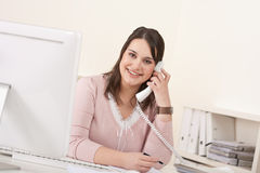 Young secretary on phone at modern office Stock Photography