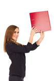 Young secretary setting aside ring binder. Stock Images