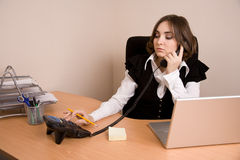 Young secretary with  telephone and laptop Stock Images