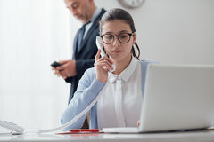 Young secretary at work Stock Images
