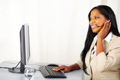 Young secretary working on a callcenter Royalty Free Stock Images
