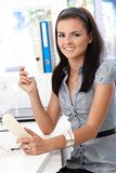 Young secretary working smiling Royalty Free Stock Photos