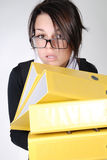Young secretary with yellow folders Royalty Free Stock Photo