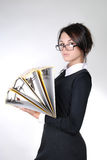 Young secretary with yellow folders Royalty Free Stock Photos