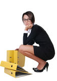 Young secretary with yellow folders Royalty Free Stock Images