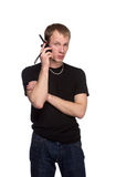 Young security officer talking through his walkie talkie. Royalty Free Stock Photography