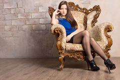 Young seductive brown haired woman posing Stock Images