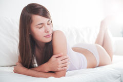 Young seductive brunette relax Stock Image