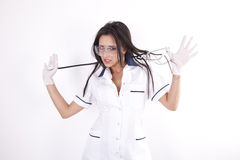 Young seductive female doctor. Young beautiful female doctor playing with her stethoscope Royalty Free Stock Images