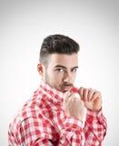 Young seductive handsome man holding collar Stock Photos