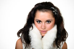 Young seductive woman. In white fur royalty free stock photo