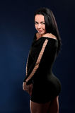 Young seductive woman in black gown Stock Photography