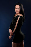 Young seductive woman in black gown Stock Image