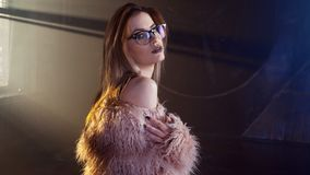 Free Young Seductive Woman, Portrait In Darkness. Girl In Stylish Pink Fur Coat And Glasses. Stock Images - 125688414