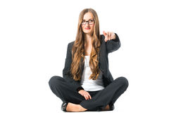 Young self confident business woman pointing Royalty Free Stock Image