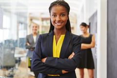 Young self confident woman as businesswoman. Young self confident women as businesswoman with her team stock images