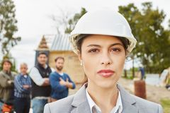 Self confident woman as architect. Young self confident women as architect with competence royalty free stock images