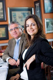 Young and senior business people stock images