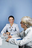 Young and senior business woman conversation Royalty Free Stock Photo