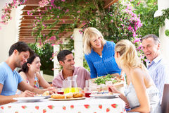 Young And Senior Couple Family Meal Royalty Free Stock Images