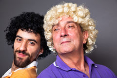 Young and Senior Man with Wig Stock Photo
