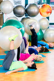 Young and senior people exercising with ball in gym Royalty Free Stock Images