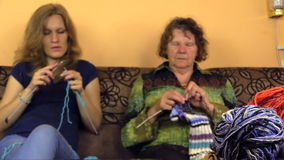 Young senior woman knit with needle color yarn. Focus change stock video footage