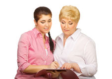 Young and senior women with folder Royalty Free Stock Photo