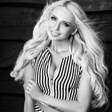 Young sensual & beauty blonde woman pose on wooden background. Black-white photo Royalty Free Stock Images