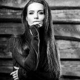 Young sensual & beauty brunette woman pose on wooden background. Black-white photo Royalty Free Stock Image