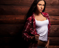 Young sensual & beauty woman in casual clothes pose on grunge wooden background. Royalty Free Stock Photo