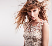 Young sensual & beauty woman in a fashionable dress. Stock Photo