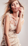 Young sensual & beauty woman in a fashionable dress. royalty free stock photos
