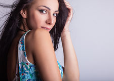 Young sensual & beauty woman in a fashionable dress. Royalty Free Stock Photography